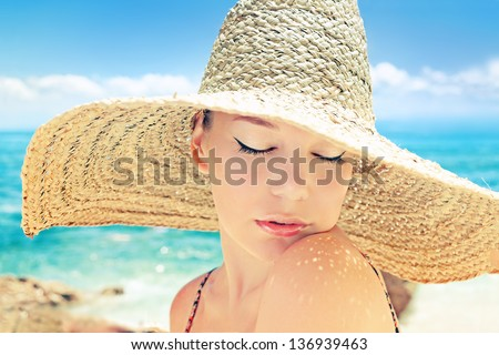 Beautiful woman on a beach on a sunny day - stock photo