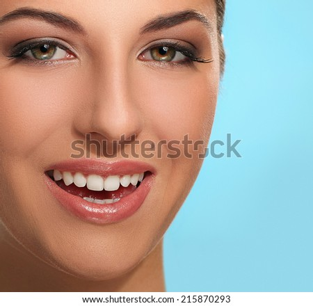 Beautiful woman on a blue background - stock photo