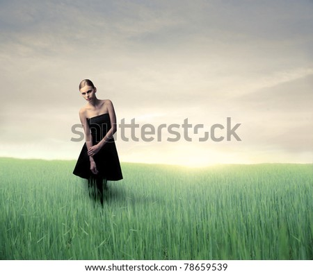 Beautiful woman on a green meadow - stock photo