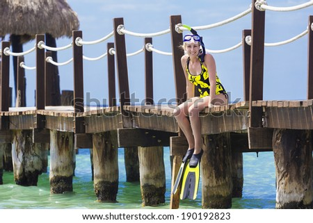 Beautiful woman on a tropical resort vacation - stock photo