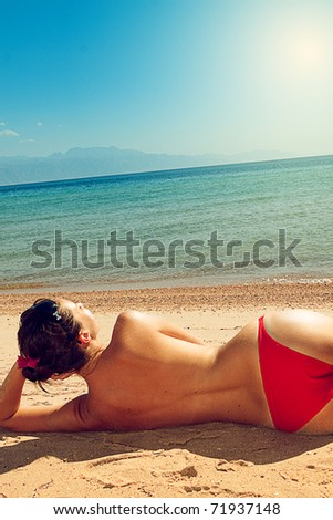 beautiful woman on background of beach - stock photo