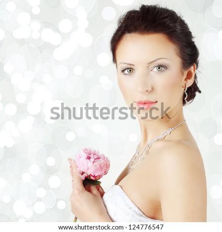 Beautiful woman on celebration background - bride, face closeup - stock photo