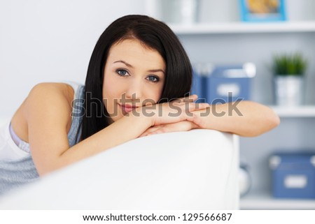 Beautiful woman on couch - stock photo