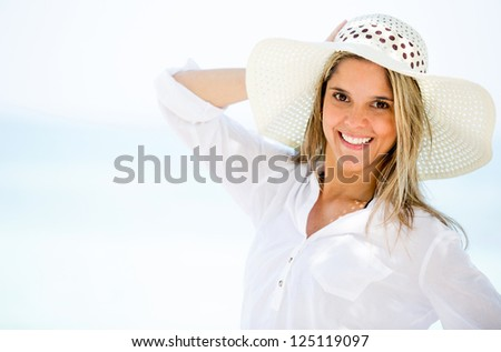 Beautiful woman on holidays looking very happy - stock photo