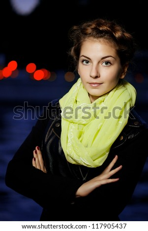 Beautiful woman on the background of night city lights - stock photo