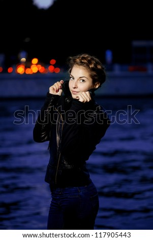 Beautiful woman on the background of night city lights - stock photo