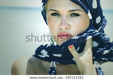 beautiful woman on the beach. Arabian style. Summer fashion. Close-up portrait. freckles - stock photo