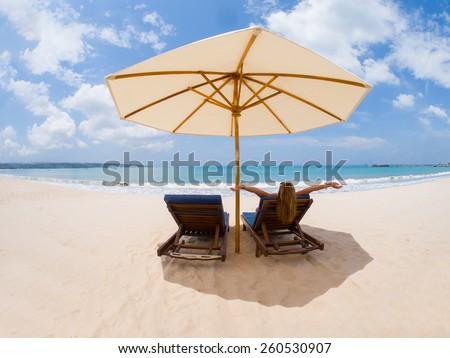 Beautiful woman on the beach. in Bali. - stock photo