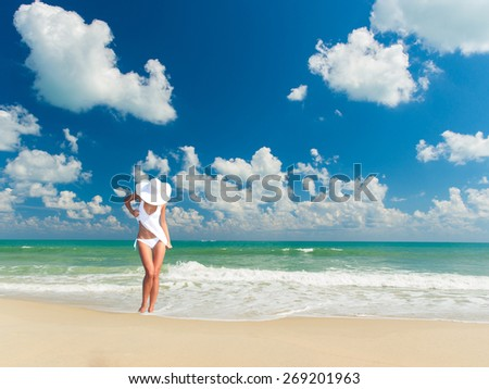 Beautiful woman on the beach in Bali Indonesia - stock photo