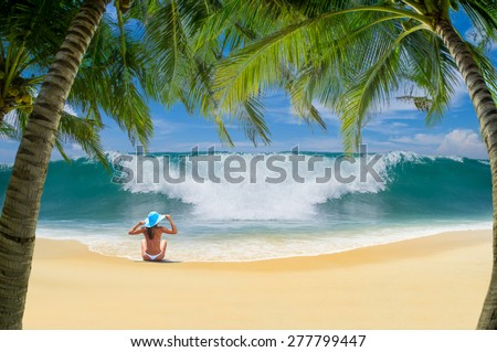 Beautiful woman on the beach. in Bali Indonesia. - stock photo