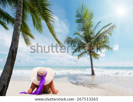 Beautiful woman on the beach with straw hat on the beach in Bali Indonesia - stock photo