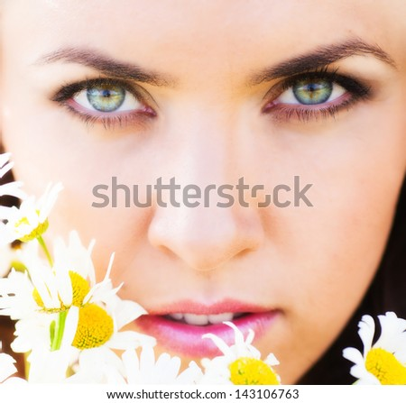 Beautiful woman on the camomile meadow - stock photo