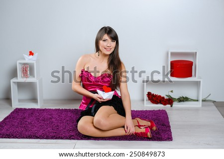 beautiful woman on Valentine's Day in the studio with a heart. - stock photo