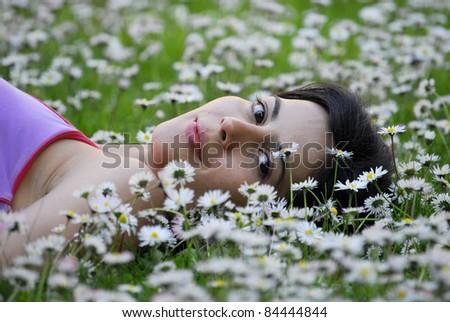 beautiful woman on white flower field. - stock photo
