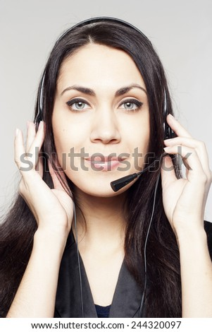 Beautiful woman operator with head-set - stock photo