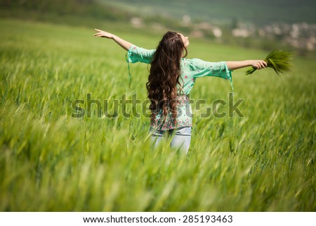 Beautiful woman Outdoors portrait, Beauty young girl outdoors enjoying nature, Woman in the field, series - stock photo