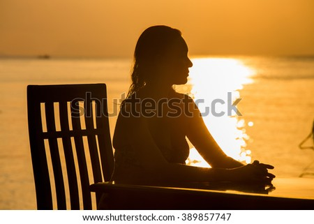 Beautiful woman outdoors silhouette portrait at sunset in island Koh Phangan, Thailand - stock photo