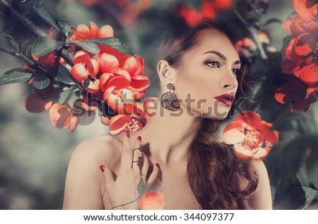 Beautiful woman over flowers background - stock photo