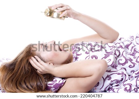 Beautiful woman oversleeping in the morning. - stock photo