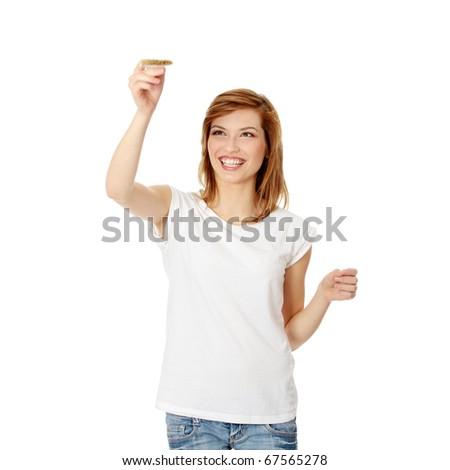 Beautiful woman painting something with paintbrush, isolated on white - stock photo
