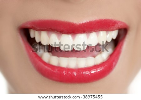 Beautiful woman perfect teeth smile with red lips - stock photo