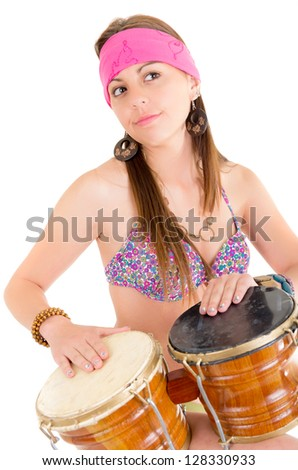 beautiful woman playing bongos studio shot - stock photo
