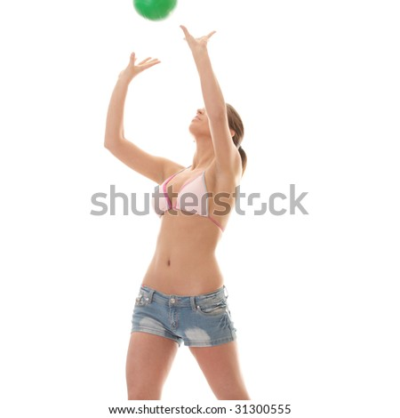 Beautiful woman playing volleyball (beach ball) isolated on white background - stock photo