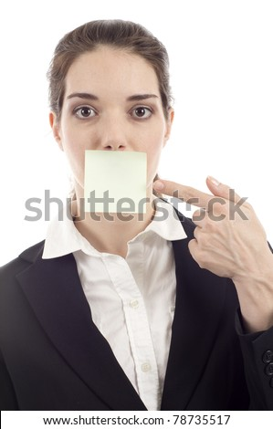 Beautiful woman pointing at the post it note on her mouth isolated over white background. Write your message. - stock photo