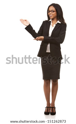 beautiful woman pointing wearing business outfit on white background - stock photo