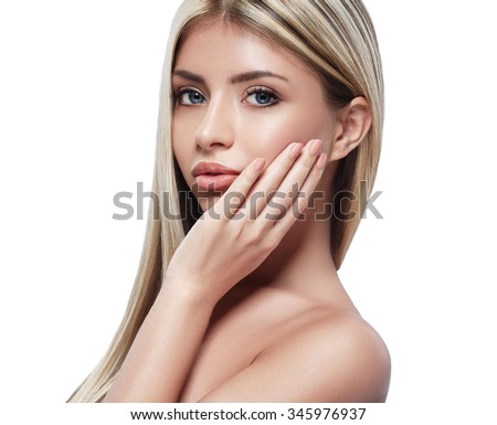 Beautiful woman portrait blond face touching her neck hand studio on white - stock photo