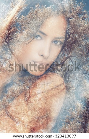 beautiful woman portrait  double exposure with olive tree - stock photo