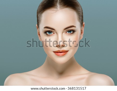 Beautiful woman portrait face studio isolated on gray background   - stock photo