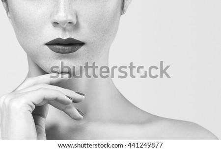 Beautiful woman portrait face studio on white black and white - stock photo