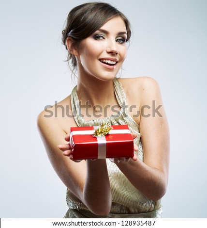 Beautiful woman portrait hold gift in christmas color style . Smiling happy girl on white background. - stock photo