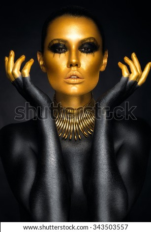 Beautiful woman portrait in gold and black colors - stock photo