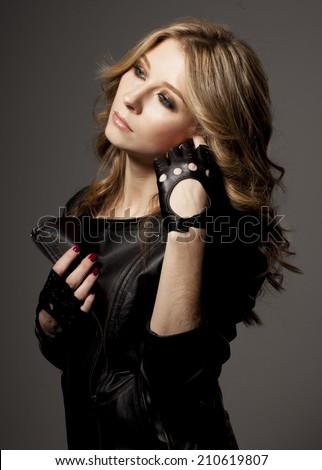 Beautiful woman portrait in rock style - stock photo