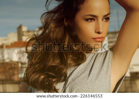 beautiful woman portrait posing on a sunny day in the city - stock photo