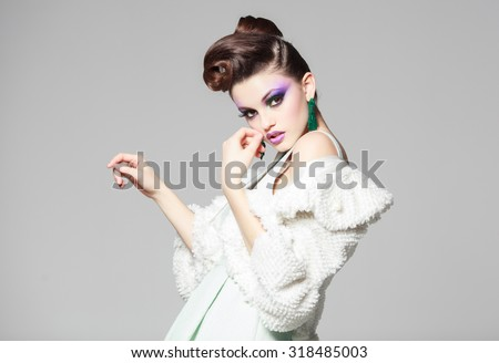 beautiful woman portrait wearing white dress and fur - stock photo