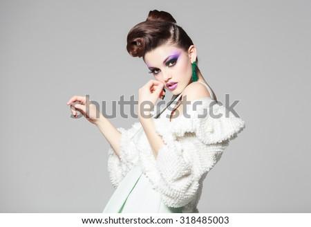 beautiful woman portrait wearing white dress and fur - stock photo