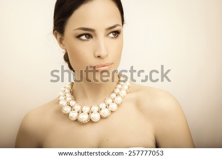 beautiful woman portrait with beauty makeup and stylish pearl necklace - stock photo