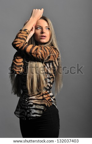 Beautiful woman posing at studio - stock photo