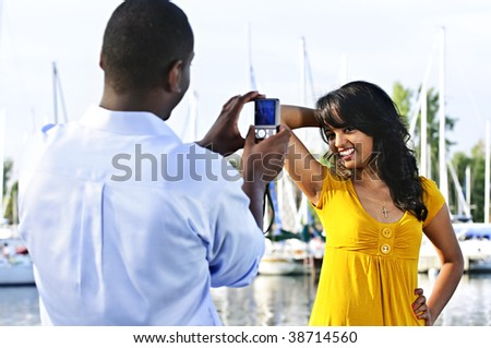 Beautiful woman posing for vacation photo at harbor - stock photo