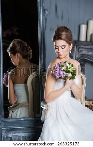 Beautiful woman posing in a wedding dress - stock photo