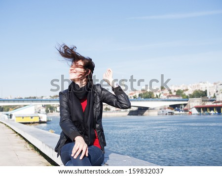 Beautiful woman posing near the river, Belgrade, Serbia - stock photo