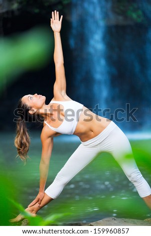 Beautiful Woman Practicing Yoga Outside In Nature, Healthy Lifestyle Wellness Concept - stock photo