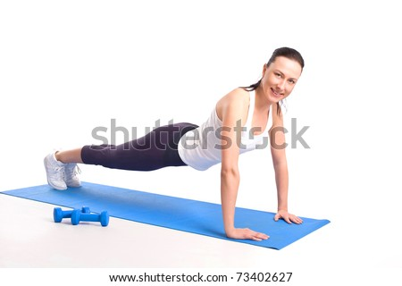 Beautiful woman pressing up - stock photo