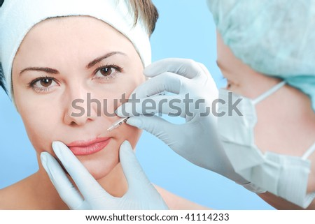 Beautiful woman receiving a injection - stock photo