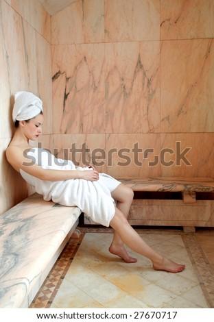 beautiful woman relaxing in a sauna - stock photo