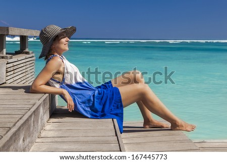 Beautiful woman relaxing on a beautiful tropical beach  - stock photo