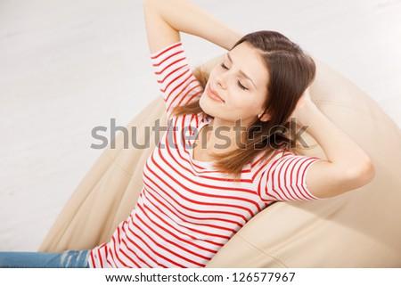 Beautiful woman relaxing on a sofa - stock photo